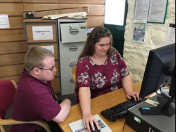 Sian Andrews working on the website with Dan Martin